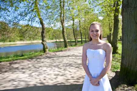 jesus standing: Girl the day of the confirmation in spring in denmark