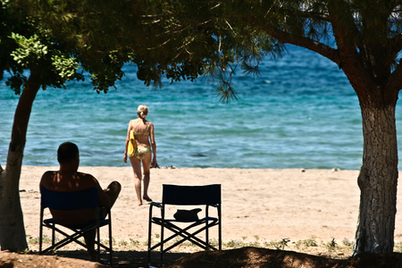 mediteranean: Man and wife at the beach in the  Peloponese in greece