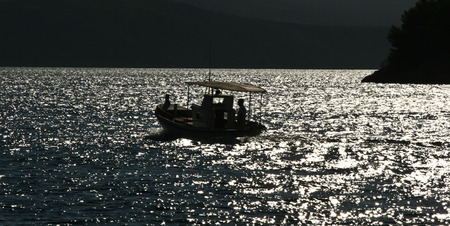 mediteranean: Fishing boats silhouette in the  Peloponese in Greece Stock Photo