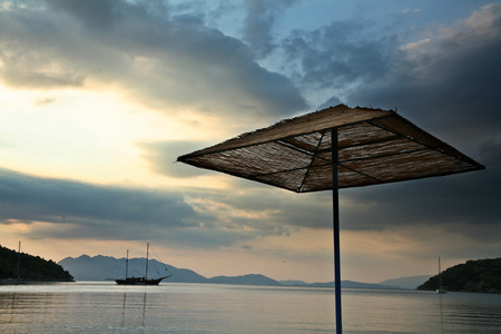 mediteranean: Parasol on a beach in the Peloponese in greece in the summer Stock Photo