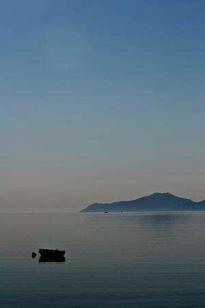 mediteranean: Boat in the morning mist  Peloponese in Greece