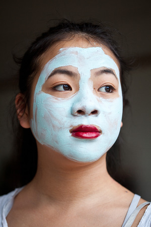 self made: Young cute girl with a self made beauty mask