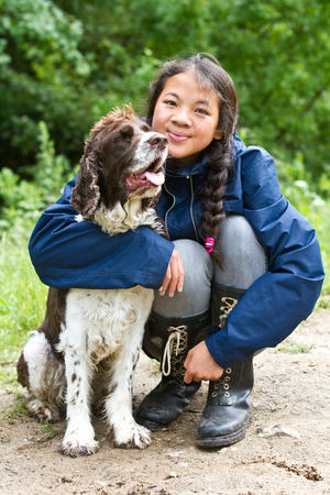 scandinavian people: Girl with a dog in denmark in the summer