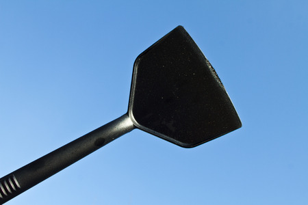 against: kitchen utensil against a dark blue sky Stock Photo