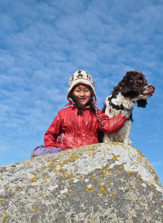 Child and dog: girl with her favorite pet photo