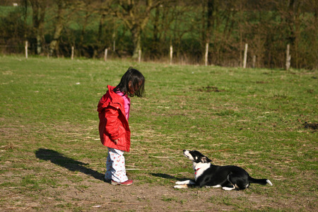 Child and dog: girl with her favorite pet