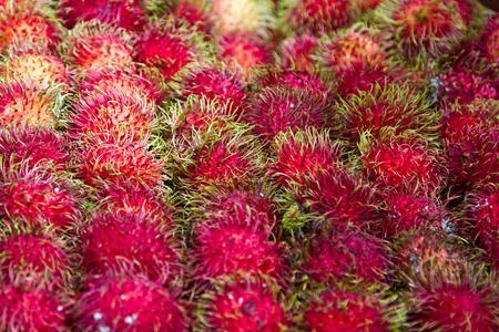 Market with fruits in Kuala Lumpur China town. Rambutan – Hairy Fruit