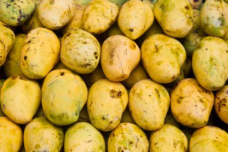Market with fruits in Kuala Lumpur China town. Mango 스톡 콘텐츠