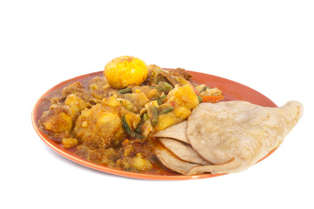 vegetable curry: Spice roti with chapati isolated on a white background