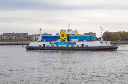 Woolwich ferry crossing the River Thames in London Stock Photo