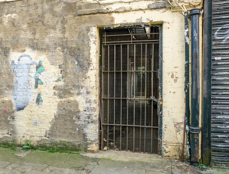Old doorway with a metal barred door padlocked and abandoned Stock Photo & Barred Ancient Stock Photos. Royalty Free Business Images