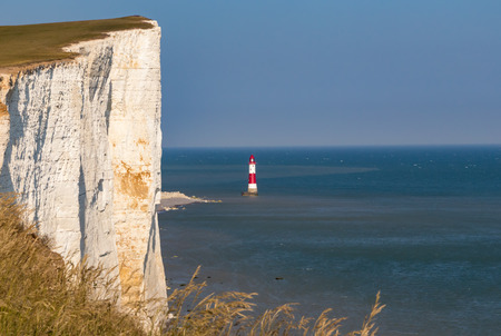 top seven: Closeup of the cliff at Beachy Head in Sussex and the lighthouse just beside on a bright sunny summers day.