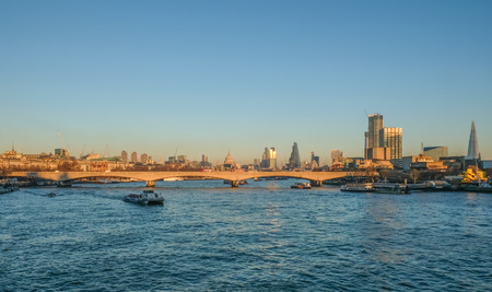water bus: London skyline looking at Waterloo Bridge and the city. Taken on a bright sunny December day,  in the late afternoon.