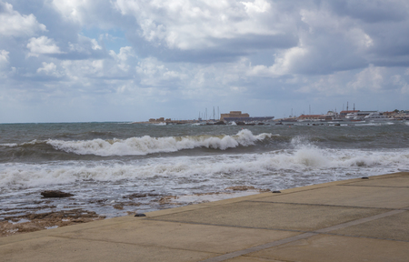 Paphos on a stormy day. Taken on a visit to Paphos on a stormy windy day and shows large waves and cloudy skies.