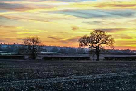 Sunset in the Essex country.  Taken on a winters day in the late afternoon and shows a beautiful sky. Stock Photo