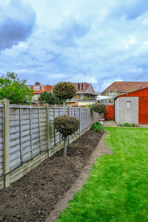 preperation: Semi-detatched garden, lawn and flower bed ready for new planting, springtime shot.