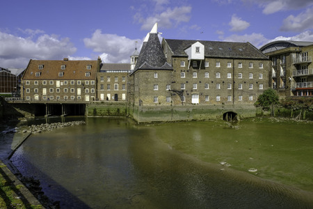Three Mills and House Mill with the River Lea in the foreground. Stock Photo