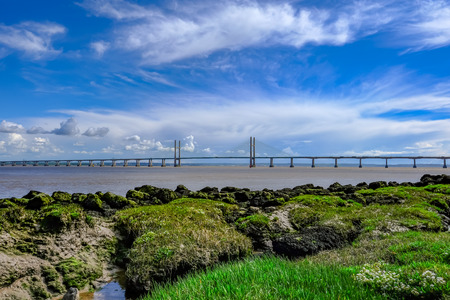 16mm: Severn suspension bridge, toll crossing between England and Wales.  Great natural foreground interest.