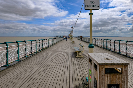 Penarth, Wales - May 21, 2017:  On Penarth Pier with wooden floor and art deco railings.