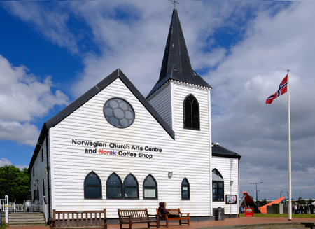 Cardiff Bay, Cardiff, Wales - May 20, 2017: Norwegian Church and arts centre.  Norwegian flag flying. Editorial