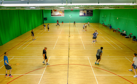 Redbridge, Essex - June 6, 2017:  Social badminton at the sports centre in Redbridge with players on court. Editorial