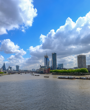 London skyline shot of famous new buildings in central London looking up the Thames River. Stock Photo
