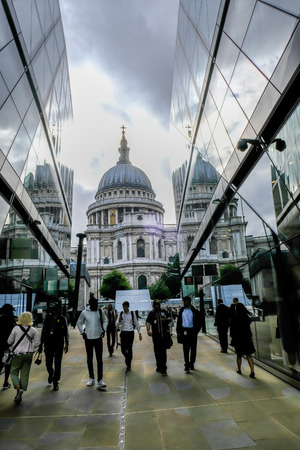 London, UK - August 3, 2017:  St. Pauls Cathederal view from the top of 1 New Change.  Shows people walking in and out of the shopping centre in the foreground. Editorial