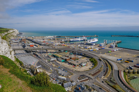 Dover, Kent, England, Uk - August 17.2017: Ariel view of the Dover Ferry Port and harbour taken from the viewing point at the Castle.  Daytime shot made with a wide angle lens. Editorial