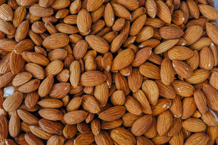 Lots of loose almonds without their shells.  Natural and organic.