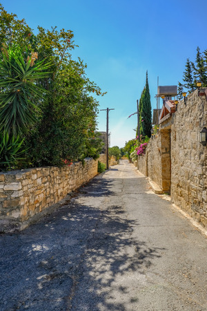 Street view in a typrical Cypriot village with no people. Taken in the morning of this narrow village road.