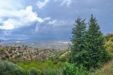 Aerial view across rural countryside in the wine growing region of Cyprus.  Stormy day shot taken in early afternoon.