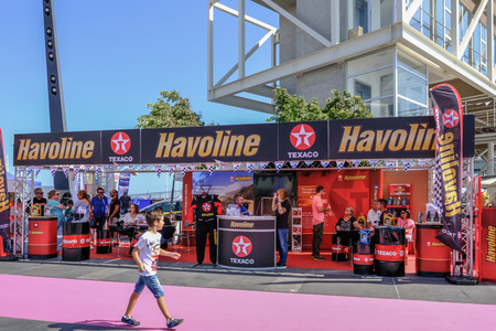 Limassol, Cyprus - October 1, 2017:  Havoline oil exhibit at a car show with young lad passing by and looking. 新聞圖片