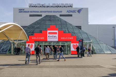 London, UK - February 16, 2018:  towards the entrance of Excel Exhibition Centre at Royal Docks, London, with people walking towards the doors.