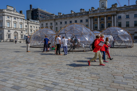 SOMERSET HOUSE, LONDON, UK - APRIL 22nd 2018: Pinksy  Pollution Pod exhibit in the centre of the square inside Somerset House. Editorial