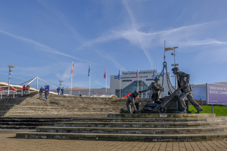 ROYAL DOCK, LONDON, UK - FEBRUARY 16, 2018: Landed sculpture by Les Johnson of London's dockers, sited on the steps up the the Excel exhibition centre