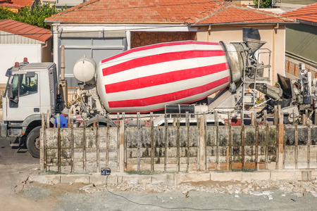 Cement mixer lorry on a delivery to building site.