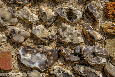 Close up background shot of an old flint wall commonly found in Sussex.