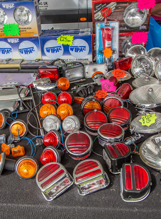 Enfield, Middlesex, UK - May 24, 2015: Selection of vintage car lamps, plain, red and orange.