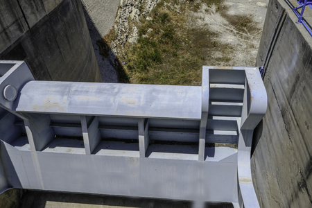 Closeup shot of the overflow, sluice gate mechanism beside the Germasogeia dam in Cyprus.