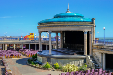 Eastbourne, Sussex, Uk - August 1, 2018: Art Deco Band Stand with seating. Taken on a sunny blue sky afternoon in summer.