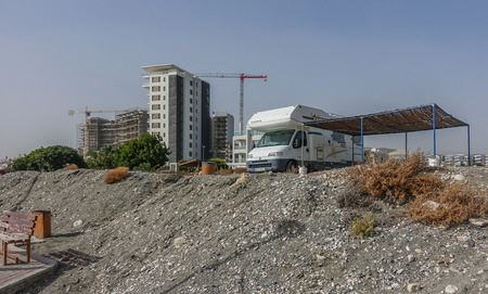 St. Barbara, Limassol, Cyprus - November 2, 2018: Camper van parked up besidethe prommendade at the sea front.  Sturdy awing built beside it.