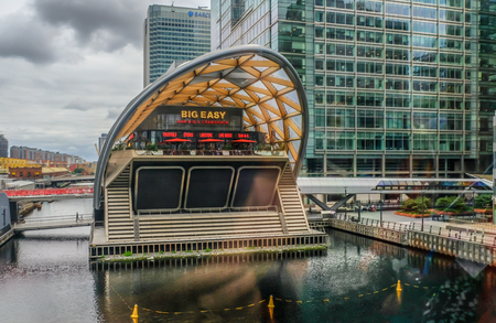 Canary Wharf, London, UK - August 18, 2018: View from the DLR train of restaurant Big Easy at Canary Wharf.