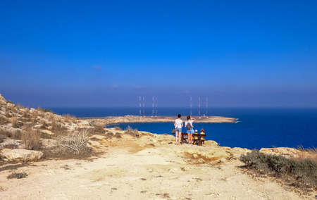 Cape Greko, Cyprus - June 25, 2018: Rear people at the viewing point looking out to sea at a magnificent view.