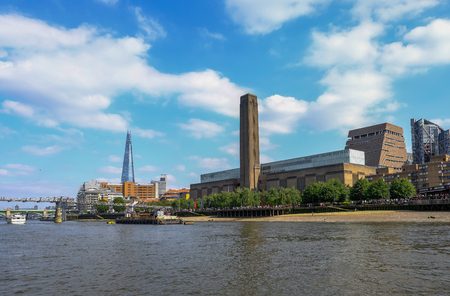South Bank, London, UK - June 8, 2018: Tate Modern seen from a clipper journey on the river Thames.