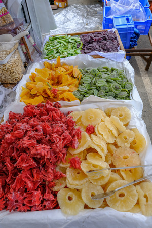 Assorted dried fruit displayed on a market stall at the fruit and vegetable street market in Limassol.  Beautiful mixed bright colours. Stock fotó