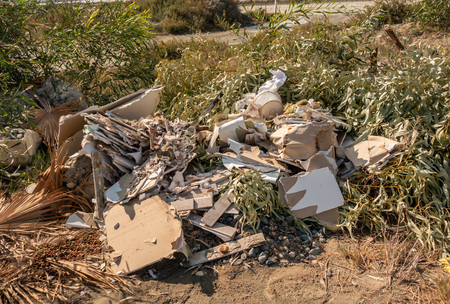 Pile of building rubbish left in abandoned in a nature spot in Limassol. Stock fotó