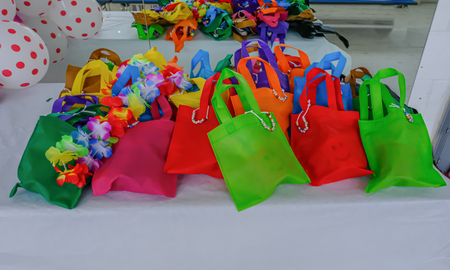 Selection of childrens party bags prepared and arranged on a white background.  Lots of vibrant colours in these goodie bags. Stock fotó