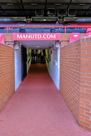 Old Trafford, Manchester, UK - January 20, 2019:  Portrait view of the original tunnel found near the dugouts at the Manchester United football stadium. Sajtókép