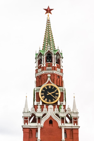 Spasskaya Tower of the Moscow Kremlin against the white sky. Moscow, Russia