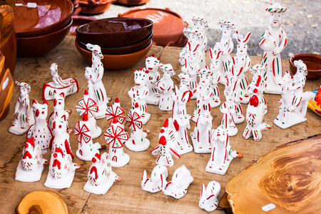 SINEU, MAJORCA, SPAIN - OCTOBER 18, 2017: Siurells, typical Majorcan hand painted clay figures with a whistle at Sineu market